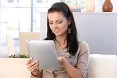 College Student Using Tablet At Home Royalty Free Stock Photography