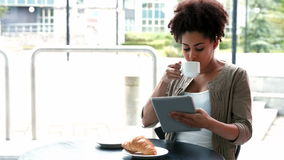 College student using tablet at campus cafe stock video footage
