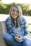College Student wearing earphones Stock Image