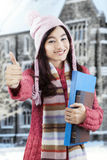 College student wearing sweater and show thumbs-up Stock Image