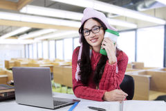 College student in winter wear at class Royalty Free Stock Photos