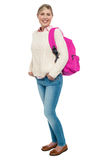 College student in winter wear posing with pink backpack Stock Image