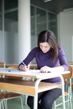 college student working in a classroom Royalty Free Stock Images