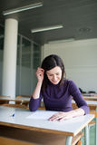 College student working in a classroom Royalty Free Stock Photography