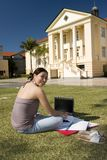 College Student working with Laptop. Freedom of working outdoor with wireless computer Stock Photo