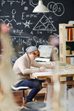 College Student Working in Science Class Royalty Free Stock Photos