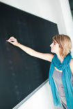 College student writing on the blackboard Stock Photos