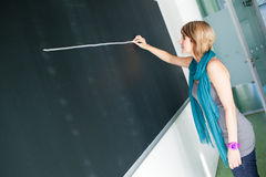 College student writing on the blackboard Royalty Free Stock Photos