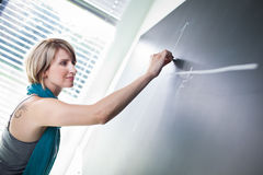College student writing on the blackboard Royalty Free Stock Photo
