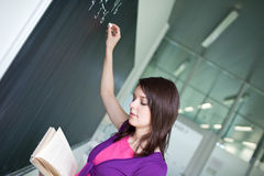 College student writing on the chalkboard Royalty Free Stock Photos