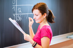 College student writing on the chalkboard Stock Image