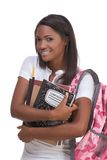 College student young African American woman. Education series - Friendly ethnic black female high school student with backpack and composition book Stock Images