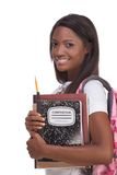 College student young African American woman. Education series - Friendly ethnic black female high school student with backpack and composition book Royalty Free Stock Photo