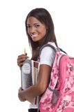 College student young African American woman. Education series - Friendly ethnic black female high school student with backpack and composition book Stock Photography