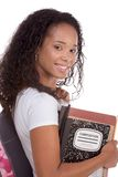 College student young African American woman. Education series - Friendly ethnic black female high school student with backpack and composition book Royalty Free Stock Images