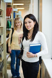 College students. A shot of two college students in a library Royalty Free Stock Photos