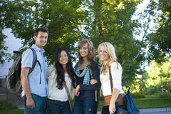 College Students. A happy group of ethnically diverse college students. Enjoying student life stock photography