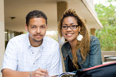 College students. Two african college students study book together outdoors Royalty Free Stock Photo