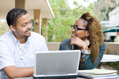 College students. Two african college students study computer laptop together outdoors Stock Photography