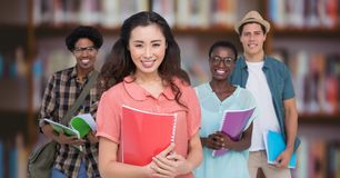 College students against blurry bookshelf Stock Image