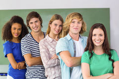 College students arms crossed. Portrait of happy college students arms crossed Stock Image