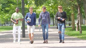 College students boy walking together on campus stock footage