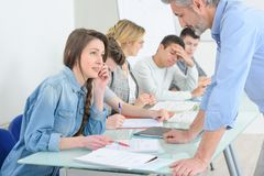 College students during class with teacher. Class royalty free stock photo