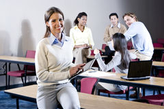 College students in classroom talking