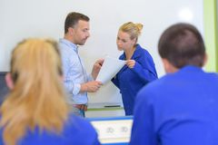 College students in classroom with teacher. College royalty free stock photos