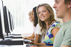 College students in a computer lab stock photos