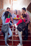 College students conversing on stairs in college Royalty Free Stock Photo