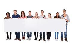 College students displaying blank billboard Stock Images