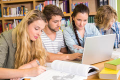 College students doing homework in library Stock Photography