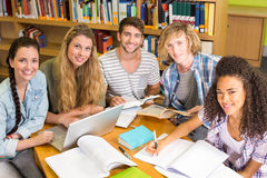 College students doing homework in library Stock Photo