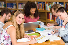 College students doing homework in library Royalty Free Stock Photo