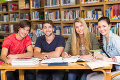 College students doing homework in library Royalty Free Stock Images