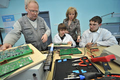 College students in electrical engineering in the classroom Stock Photography