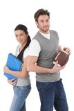 College students with folders and rugby ball Royalty Free Stock Photos