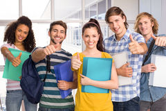 College students gesturing thumbs up Stock Photography