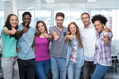 College students gesturing thumbs up. Portrait of happy college students gesturing thumbs up Stock Image