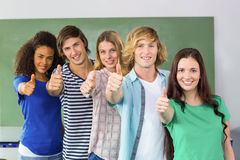 College students gesturing thumbs up. Portrait of happy college students gesturing thumbs up Stock Images