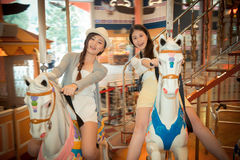 College students going to foreign sightseeing. Asian college students going to foreign sightseeing playing to the local amusement park and riding a carousel Stock Photo