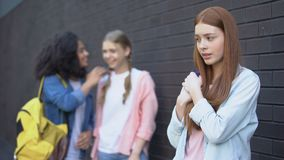 College students gossiping about new red-haired classmate, psychological trauma. Stock footage stock video