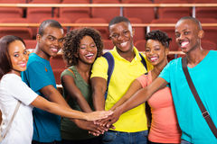 College students hands together Royalty Free Stock Photo