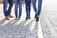 College students hanging out on campus. Enjoying campus life. Cropped photo of group of college students walking together on campus Stock Image
