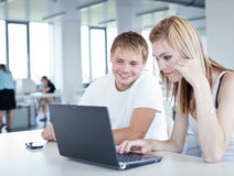 College students having fun studying together Royalty Free Stock Image
