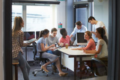 College Students Having Informal Meeting With Tutors Stock Photos