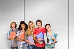 Composite image of college students holding books in library royalty free stock images