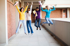 College students jumping. Group of female college students jumping up Royalty Free Stock Photos