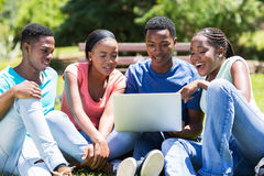 College students laptop computer. Modern african college students using laptop computer Stock Photography